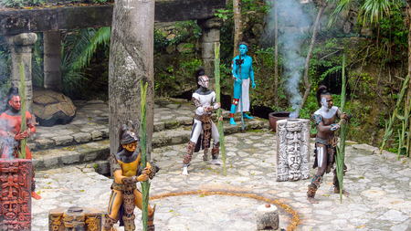 XCARET, MEXICO - NOV 8, 2015: Unidentified men with body paint dressed as the Maya indian. The Mayan are a group of Indigenous people of Mesoamerica Editorial
