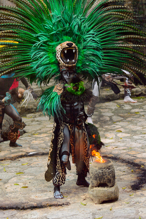 XCARET, MEXICO - NOV 8, 2015: Unidentified man wears a costume of a Maya indian. The Mayan are a group of Indigenous people of Mesoamerica Editorial