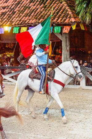 XCARET, MEXICO - NOV 7, 2016: Unidentified cowboy rides a horse in the Xcaret park, Mexioc Editorial