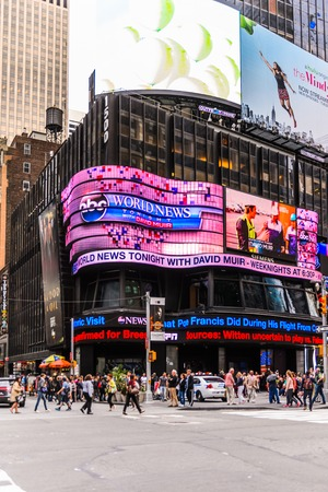 NEW YORK, USA - SEP 22, 2015: ABC news screen at the Times Square, a major commercial neighborhood in Midtown Manhattan, New York City 報道画像