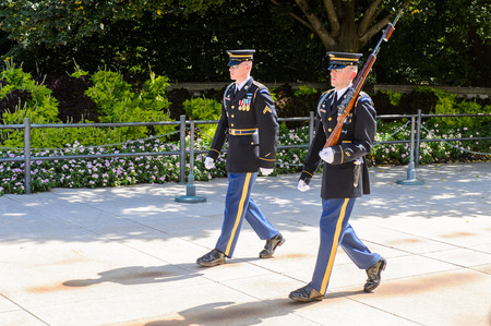 WASHINGTON DC, USA - SEP 24, 2015: Change of the guard near the Unknown Soldier tomb at the Arlington national cemetery. Its a United States military cemetery