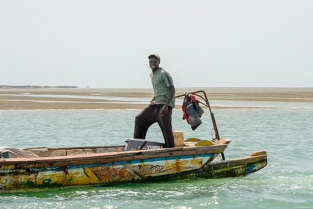 ORANGO ISLAND, GUINEA BISSAU - MAY 3, 2017: Unidentified local man sails in a boat on the Orango Island, Guinea Bissau