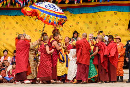 TRIMPHU, BHUTAN - MAR 8, 2017: Unidentified Ngalops people in traditional clothes celebrate some holiday. Ngalops is one of the most populous ethnic groups of Bhutan Editorial