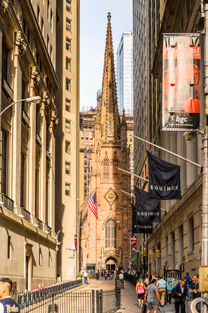 NEW YORK, USA - SEP 25, 2015: Architecure of the Wall Street, a eight blocks street in the Financial District of lower Manhattan, New York City. Editorial