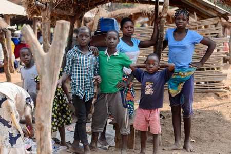 BOHICON, BENIN - JAN 12, 2017: Unidentified Beninese children gather at the local market. Benin children suffer of poverty due to the bad economy.