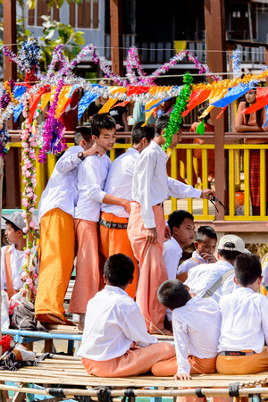 INLE LAKE, MYANMAR - AUG 30, 2016: Unidentified Burmese people on a pier of the Inle Lake. 68 per cent of Myanma people belong to Bamar ethnic group