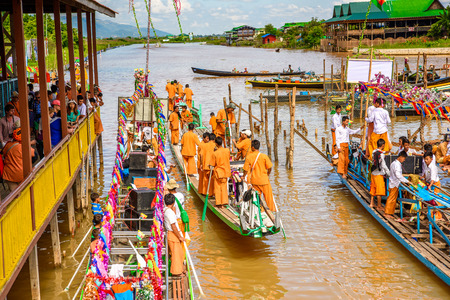INLE LAKE, MYANMAR - AUG 30, 2016: Unidentified Burmese people on a pier of Inle Lake. 68 per cent of Myanma people belong to Bamar ethnic group