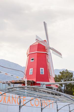 KEMER, TURKEY - APR 15, 2015: Wind mill of the Touristic Amsterdam hotel in Kemer, Turkey. Kemer is a popular touristic destination on the Mediterranean sea coast