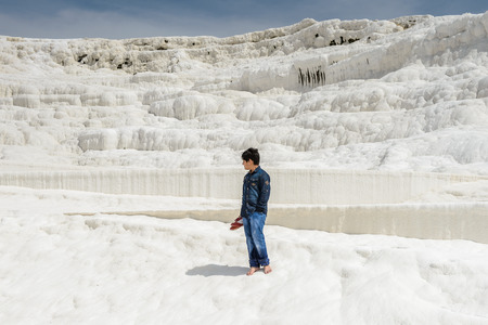 PAMUKKALE, TURKEY - APR 18, 2015: Unidentified little boy on the travertines of Pamukkale, Turkey. It's a UNESCO World Heritage site Editorial