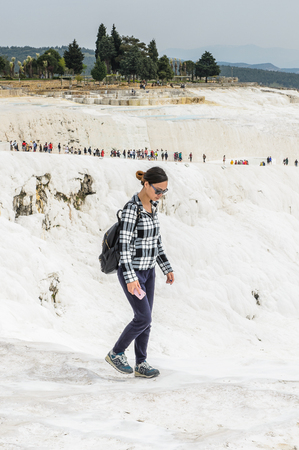 PAMUKKALE, TURKEY - APR 18, 2015: Unidentified beautiful girl on the travertines of Pamukkale, Turkey. It's a UNESCO World Heritage site Editorial