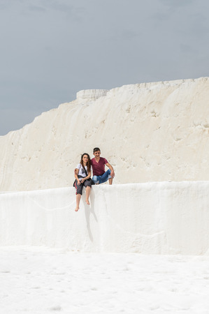 PAMUKKALE, TURKEY - APR 18, 2015: Unidentified couple on the travertines of Pamukkale, Turkey. It's a UNESCO World Heritage site
