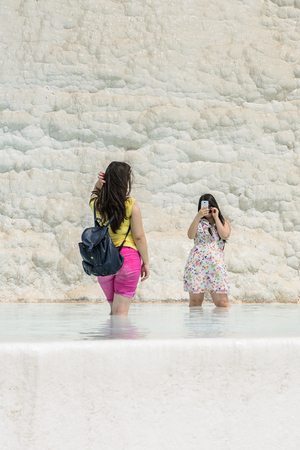 PAMUKKALE, TURKEY - APR 18, 2015: Unidentified tourist on the travertines of Pamukkale, Turkey. It's a UNESCO World Heritage site Editorial