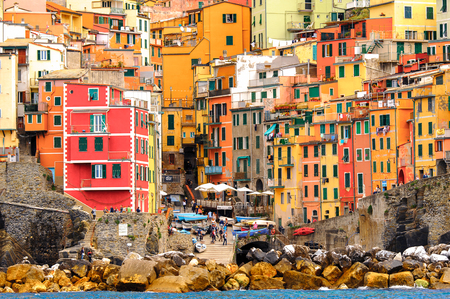RIOMAGGIORE, ITALY - MAY 5, 2016: Panorama of Riomaggiore, a village in province of La Spezia, Liguria, Italy. It's one of the lands of Cinque Terre, UNESCO World Heritage Site