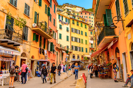 RIOMAGGIORE, ITALY - MAY 5, 2016: Central street of Riomaggiore (Rimazuu), a village in province of La Spezia, Liguria, Italy. Cinque Terre, UNESCO World Heritage Site