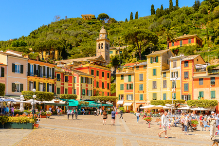 PORTOFINO, ITALY - MAY 4, 2016: Beautiful harbour of Portofino, an Italian fishing village, Genoa province, Italy. A vacation resort with celebrity and artistic visitors.
