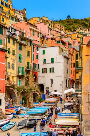 RIOMAGGIORE, ITALY - MAY 5, 2016: Boats in Riomaggiore, a village in province of La Spezia, Liguria, Italy. Cinque Terre, UNESCO World Heritage Site