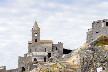 PORTO VENERE, ITALY - MAY 5, 2016: Church of St. Peter in Porto Venere, Italy. P Venere and the villages of Cinque Terre are the UNESCO World Heritage Site. Editorial