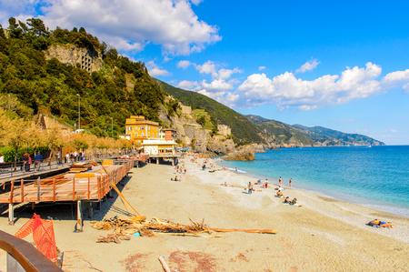 MONTEROSSO, ITALY - MAY 5, 2016: Beach of Monterosso al Mare, a small town in province of La Spezia, Liguria, Italy. It's one of the lands of Cinque Terre, UNESCO World Heritage Site