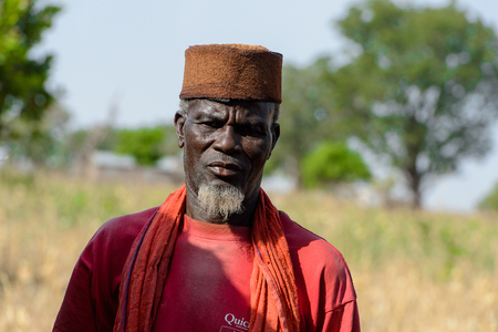 KOUTAMMAKOU, TOGO - JAN 13, 2017: Unidentified Togolese man looks ahead in the village. Togo people suffer of poverty due to the bad economy. Editorial