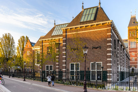 AMSTERDAM, NETHERLANDS - MAY 1, 2015:  Rijksmuseum of Amsterdam in the evening. Amsterdam is the capital city and most populous city of the Kingdom of the Netherlands