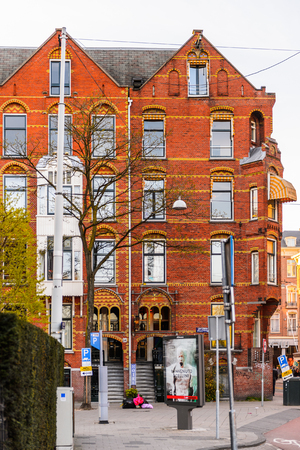 AMSTERDAM, NETHERLANDS - MAY 1, 2015: Architecture of Amsterdam in the evening. Amsterdam is the capital city and most populous city of the Kingdom of the Netherlands