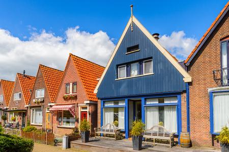VOLENDAM, NETHERLANDS - MAY 2, 2015: Houses in Volendam, Netherlands. Volendam is a popular touristic destination in North Holland