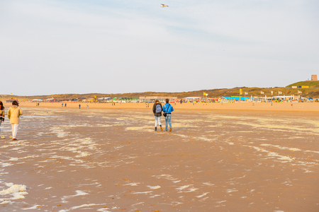 THE HAGUE, NETHERLANDS - MAY 2, 2015: Unidentified people of the coast of the North Sea in the Hague, Netherlands. Hague is the capital of the province South Holland