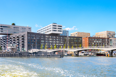 AMSTERDAM, NETHERLANDS - JUN 1, 2015: Modern acrchitecture of Amsterdam. Amsterdam is the capital city and most populous city of the Kingdom of the Netherlands Redactioneel