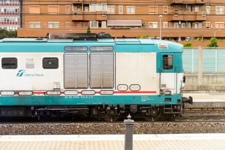 FLORENCE, ITALY - MAY 6, 2016: Trenitalia company train in movement near Florence. Trenitalia is the primary train operator in Italy Editorial