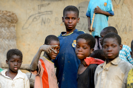 DAGOMBA VILLAGE, GHANA - JAN 14, 2017: Unidentified Dagomban children hang out in the local village. Dagombas are ethnic group of Northern Ghana Editorial