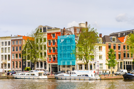AMSTERDAM, NETHERLANDS - JUNE 1, 2015: Architecture of canals of Amsterdam, Netherlands. Amsterdam is the capital of Netherlands and a popular touristic destination Editorial