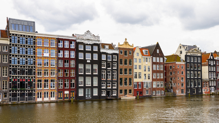 AMSTERDAM, NETHERLANDS - JUNE 1, 2015: Architecture of Damrak street of Amsterdam, Netherlands. Amsterdam is the capital of Netherlands and a popular touristic destination Editorial