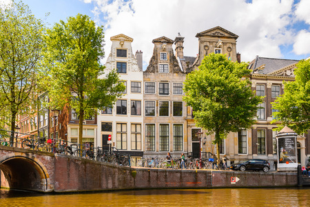 AMSTERDAM, NETHERLANDS - JUN 1, 2015: Architecture of Amsterdam. Amsterdam is the capital city and most populous city of the Kingdom of the Netherlands