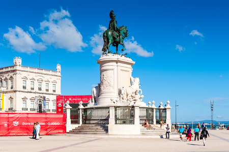 LISBON, PORTUGAL - JUN 20, 2014:  Statue of King Jose I on the Commerce Square (Praca do Comercio) in Lisbon, Portugal. The Square was destoryed by the 1755 Lisbon Earthquake and then it was reconstructed