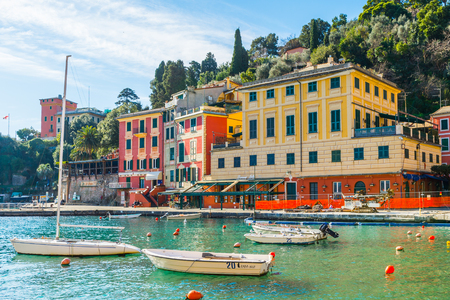 PORTOFINO, ITALY - MAR 7, 2015: Colorful houses and boats on the Piazzetta square of Portofino. Portofino is a resort famous for its picturesque harbour Editorial