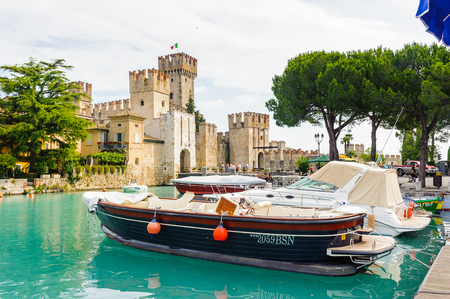 SIRMIONE, ITALY - JUNE 26, 2014: Castello Scaligero di Sirmione (Sirmione Castle), built in XIV century, Lake Garda, Sirmione, Italy