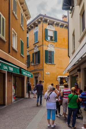 SIRMIONE, ITALY - JUNE 26, 2014: Touristic area in the Old Town of Sirmione, Italy. Sirmione became popular touristic destination on the Lake garda, the largest lake in Italy Sajtókép