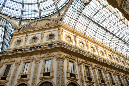 MILAN, ITALY - DEC 23, 2014: Galleria Vittorio Emanuele II, one of the worlds oldest shopping malls. The gallery is built between 1865 and 1877 by Giuseppe Mengoni