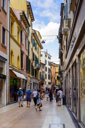 VERONA, ITALY - JUN 26, 2014: Touristic and shopping street in the old town of Verona, Italy. City of Verona is a UNESCO World Heritage site