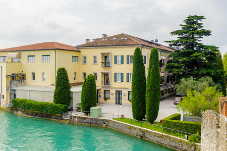 SIRMIONE, ITALY - JUNE 26, 2014: Beautiful panoramic view of the Sirmione town, Italy. Sirmione became popular touristic destination on the Lake garda, the largest lake in Italy Sajtókép