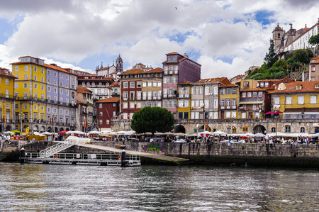 PORTO, PORTUGAL - JUN 21, 2014:  Ribeira quarter, Valley Douro, traditional sight, UNESCO World Heriatge site. View from the River Douro, one of the major rivers of the Iberian Peninsula (2157 m) Editorial