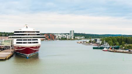 TURKU, FINLAND - JULY 22, 2013: Cruiser liner of the Viking Line company in the  Port of Turku, Finland, July 22, 2013. Port of Turku has a status of major Baltic Sea trading post