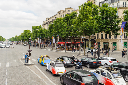 PARIS, FRANCE - JUN 17, 2014: Avenue des Champs-Elysees in Paris, France. Champs-Elysees is one of the world's most famous streets, and is one of the most expensive strips of real estate in the world