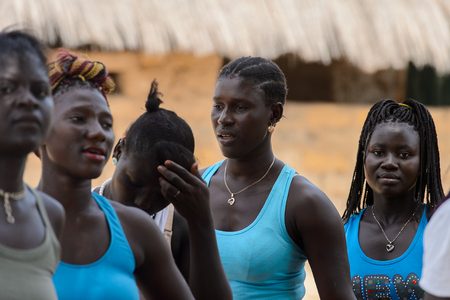 ORANGO ISL., GUINEA BISSAU - MAY 3, 2017: Unidentified local Women sing and dance during Vaca Bruto, traditional Mask dance