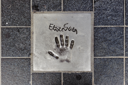 CANNES, FRANCE - JUN 25, 2014: Ettore Scola hand mark on the alley of fame in Cannes, Cote d'Azur, France 에디토리얼