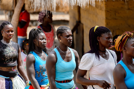 ORANGO ISL., GUINEA BISSAU - MAY 3, 2017: Unidentified local Women dance national dance during Vaca Bruto, traditional Mask dance Editorial