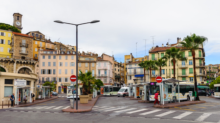 CANNES, FRANCE - JUNE 25, 2014: Promenade de la Croisette in Cannes. Cannes hosts the annual Cannes Film festival from 1949
