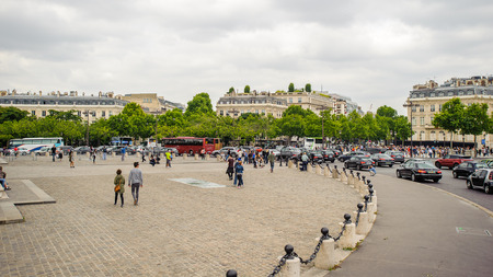 PARIS, FRANCE - JUN 17, 2014: Place de Charles de Gaulle near the Arc de Triomphe de l'Etoile in Paris, France. It's one of the most important monuments in Paris
