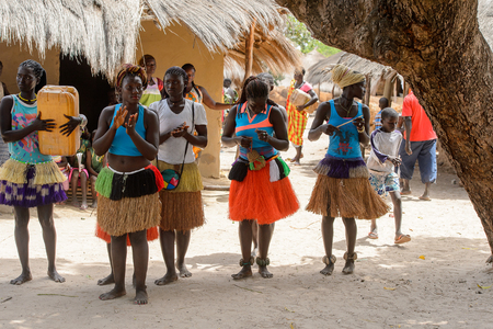 ORANGO ISL., GUINEA BISSAU - MAY 3, 2017: Unidentified local Women in straw skirts dance  during Vaca Bruto, traditional Mask dance