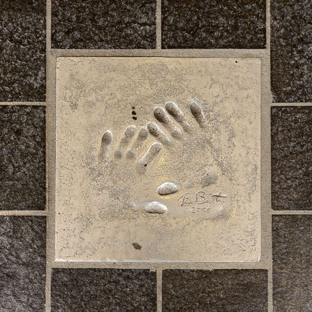 CANNES, FRANCE - JUN 25, 2014: hand mark on the alley of fame in Cannes, Cote d'Azur, France Éditoriale